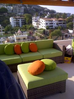lounge seats on roof top terrace