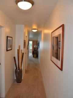 Hallway from the entry to the living area.  The master bedroom and guest bath are to the left.