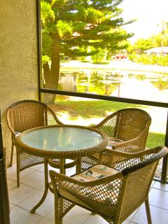 Enjoy viewing ducks and turtles while relaxing on your lanai