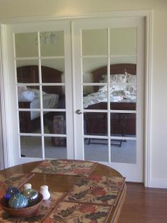 French doors lead from the dining area to the Master Bedroom