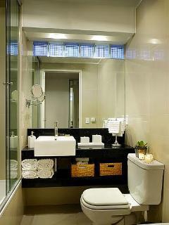 Bathroom with Heated Floors, Toilet, Bidet, and Granite Countertops