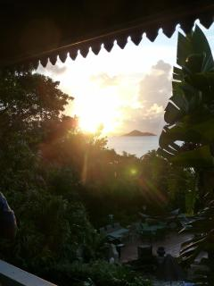 Typical sunset from the wrap around porch of Sunset Watch Upper Level Villa.