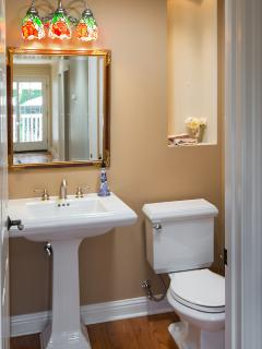 Hallway half bath, beautiful french sink with accouterments!