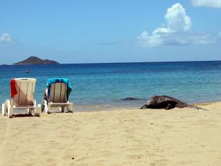Sundowner Villa's beach access is second to none ! We've got a chair and a towel waiting for you !