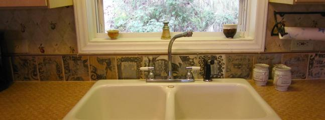 Handmade tiles above the kitchen sink.
