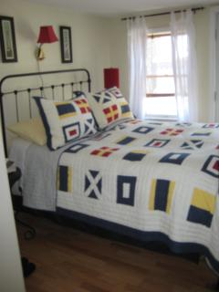 Nautical bedroom with private access to deck.