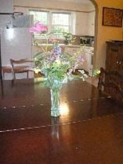 Dining room table with flowers from garden and view toward kitchen