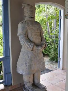 Terra Cotta warrior from Xian stands guard to insure tranquility and peace during your stay.