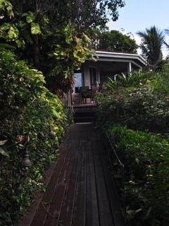 View from one of the romantic stone paths amongst the gardens at Sunset Watch beachfront Villas.