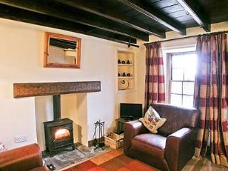 the lounge with wood burning stove and far reaching views