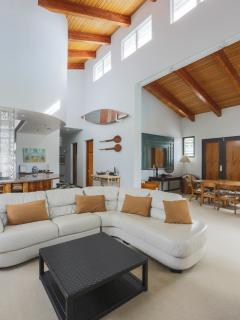 Cathedral ceiling & Koa wood provide a large relaxing area in the home