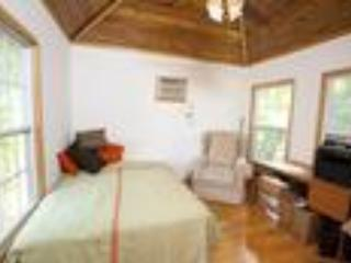 Guest Bedroom w/hardwood floors, vaulted ceiling, and air con