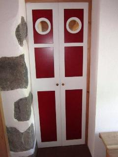 A door to the bathroom