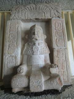 An intricately caved stone statue 10 minutes from our hotel at Uxmal