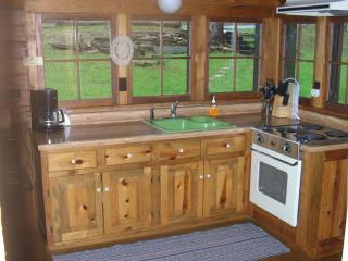 Kitchen is supplied with all cookware as well as coffeemaker, toaster, microwave & full-size fridge.