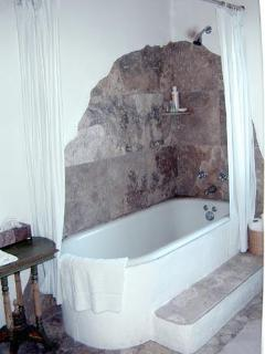 Bathroom with antique tub and custom stonework