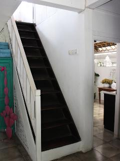 Stairs next to bathroom