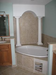 master bath tub, but it has a shower and two sinks
