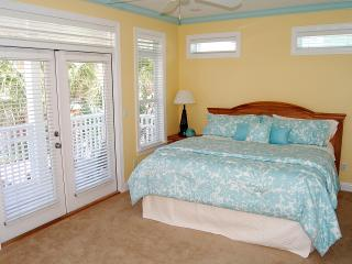 2nd Floor MBR - King size bed, with TV, full bathroom and covered balcony