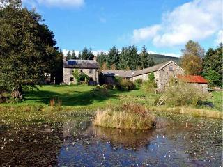 CWM BEDW FARMHOUSE, family friendly, character holiday cottage, with open fire
