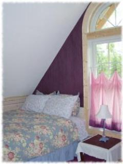 Find cottage comfort in the upstairs bedroom.