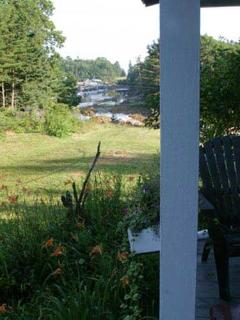 View of the back cove and the Atlantic Ocean beyond from the front porch