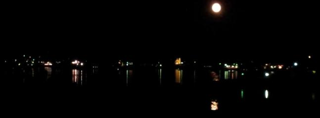 Full moon rising over the lights of Boothbay Harbor