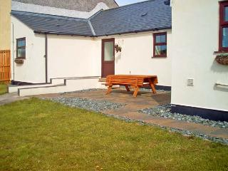 TY'N CAE COTTAGE, pet friendly, country holiday cottage, with a garden in