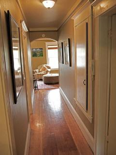 The long hall to the living room is original Douglas Fir.  It glows!