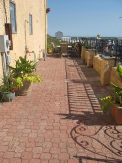Gated oceanfront side patio!