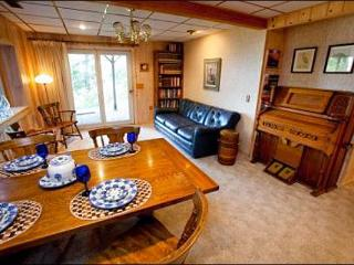 Living Room Includes a Sleeper Sofa and Piano, Opens up to the Dining Area