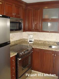 Updated kitchen with granite, stainless, etc