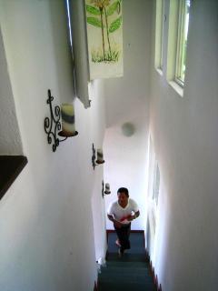 Bismark, the caretaker, ascending stairway