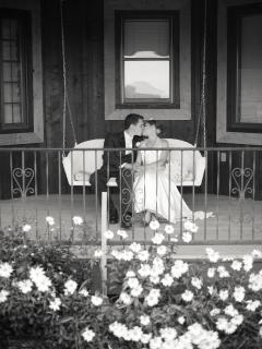 sharing a kiss on the Cedar Bend porch