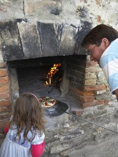 Cooking in the pizza oven