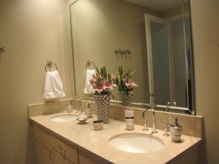 Oversized master bathroom with his and her sinks and rain shower