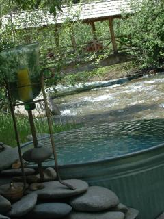 natural hot water tub on river view of entrance