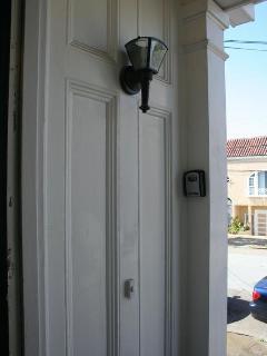 Lock box to right of door
