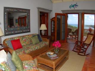 You enter a spacious living room with access to the big covered deck...comfort, views and breezes!