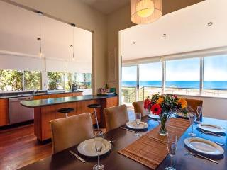 Dining and kitchen with ocean views