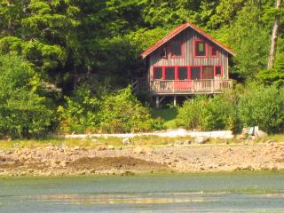 The beach and cottage (view from the water)