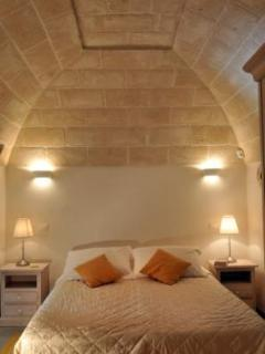 Trulli Stella Main Bedroom in traditional 'lamia' with french doors to patio and gardens