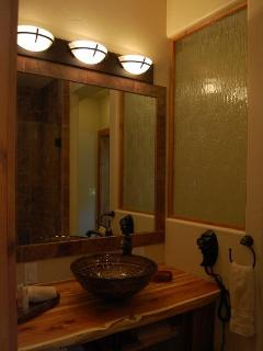 Beautiful bathroom with custom Cedar countertop and beautiful vessel sink