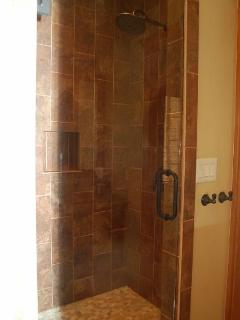Luxury shower with custom tile and rain shower head