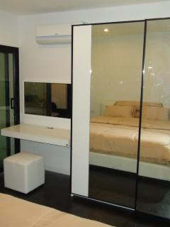 bedroom with mirror wardrobe 202