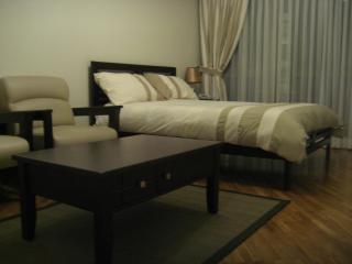 Double Bed, coffee table and armchairs