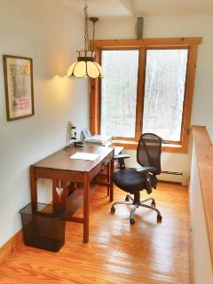 office space with WiFi overlooks open kitchen/LR/dining.below