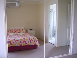 Main room has ensuite,reversed air con, glass sliding doors to balcony, wardrobes, table, clock lamp