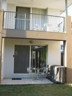 Showing upstairs balcony and downstairs .Back patio  & BBQ area
