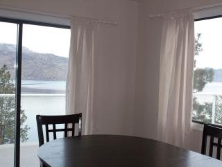 Dinning room with unobstructed lakeview & patio door leading to outdoor dinning